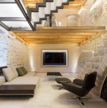 Comment mettre en valeur un mur intérieur en pierre ancienne ?